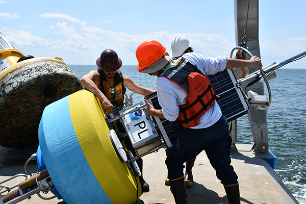 The NOAA CBIBS team prepares the new Potomac buoy to be deployed off Point Lookout in May 2019.